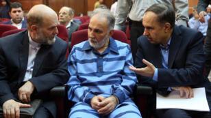 رئيس بلدية طهران السابق محمد علي نجفي خلال محاكمته