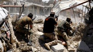 جنود عراقيون في منطقة الزنجيلي في الموصل في 7-06-2017