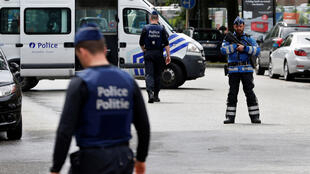 عناصر من الشرطة البلجيكية أثناء تنفيذ مداهمات