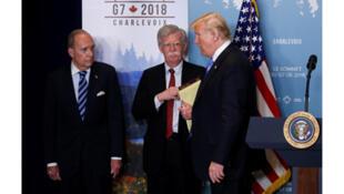 / ترامب  وهو يغادر قمة G7
