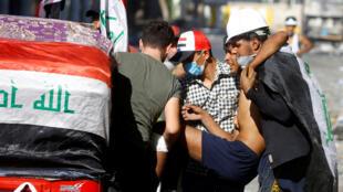 نقل أحد الجرحى نتجية التظاهرات في العراق